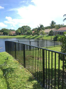 a backyard with a nice new aluminum fencing